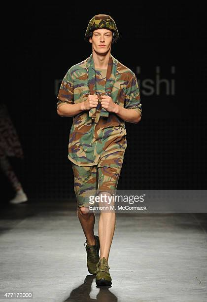A model walks the runway at the Maharishi show during The London Collections Men SS16 at The Old Sorting Office on June 14 2015 in London England