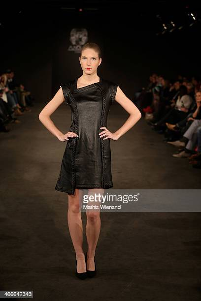A model walks the runway at the Maison Anoufa fashion show during Platform Fashion Dusseldorf on February 2 2014 in Dusseldorf Germany