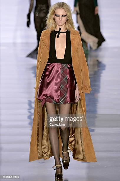 A model walks the runway at the Maison Margiela Autumn Winter 2015 fashion show during Paris Fashion Week on March 6 2015 in Paris France