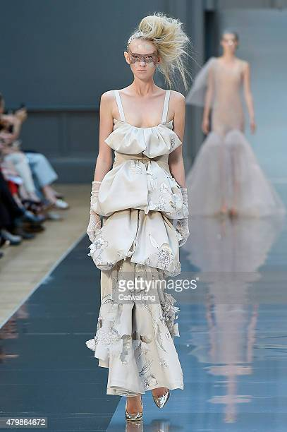 A model walks the runway at the Maison Margiela Autumn Winter 2015 fashion show during Paris Haute Couture Fashion Week on July 8 2015 in Paris France