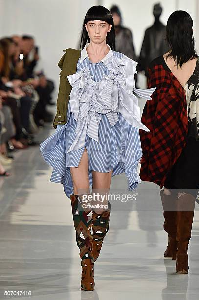 A model walks the runway at the Maison Margiela Spring Summer 2016 fashion show during Paris Haute Couture Fashion Week on January 27 2016 in Paris...