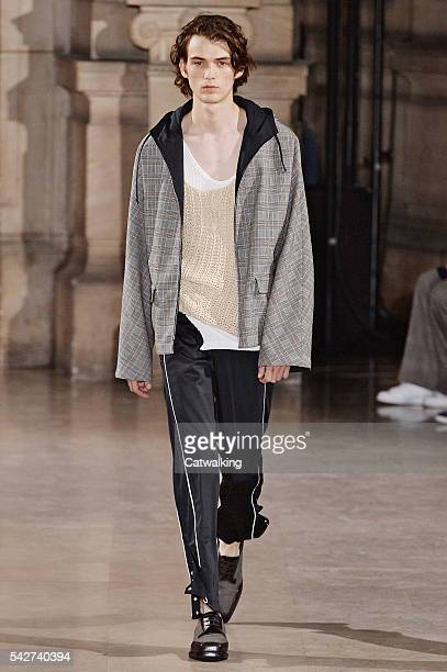 A model walks the runway at the Maison Margiela Spring Summer 2017 fashion show during Paris Menswear Fashion Week on June 24 2016 in Paris France