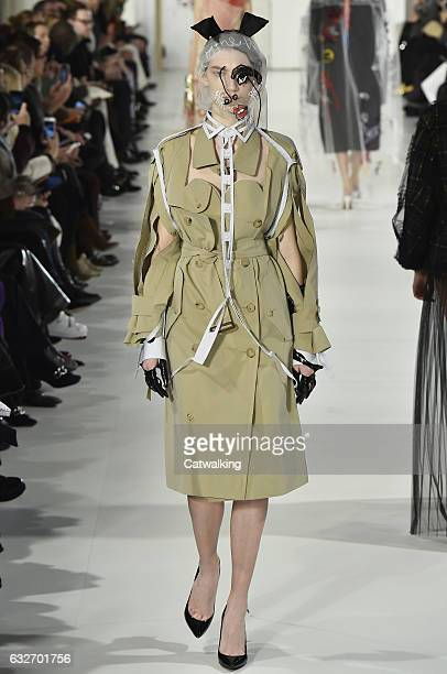 A model walks the runway at the Maison Margiela Spring Summer 2017 fashion show during Paris Haute Couture Fashion Week on January 25 2017 in Paris...