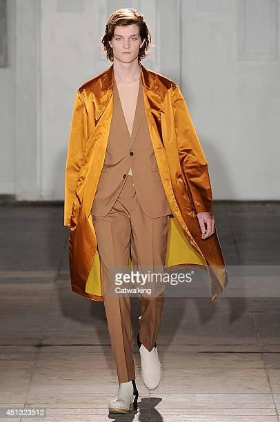 A model walks the runway at the Maison Martin Margiela Spring Summer 2015 fashion show during Paris Menswear Fashion Week on June 27 2014 in Paris...