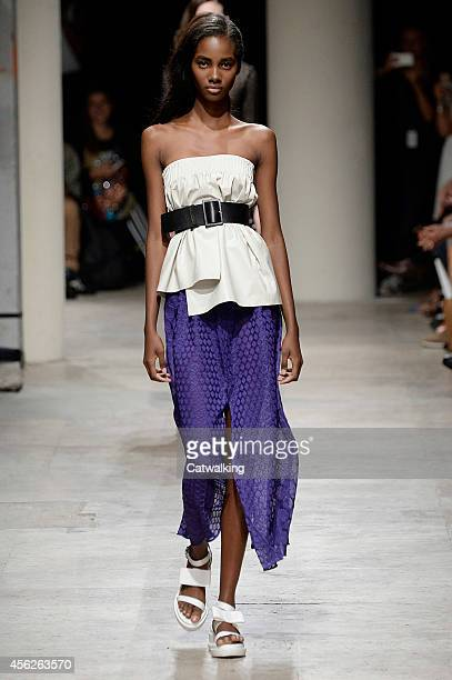 A model walks the runway at the Maison Rabih Kayrouz Spring Summer 2015 fashion show during Paris Fashion Week on September 28 2014 in Paris France