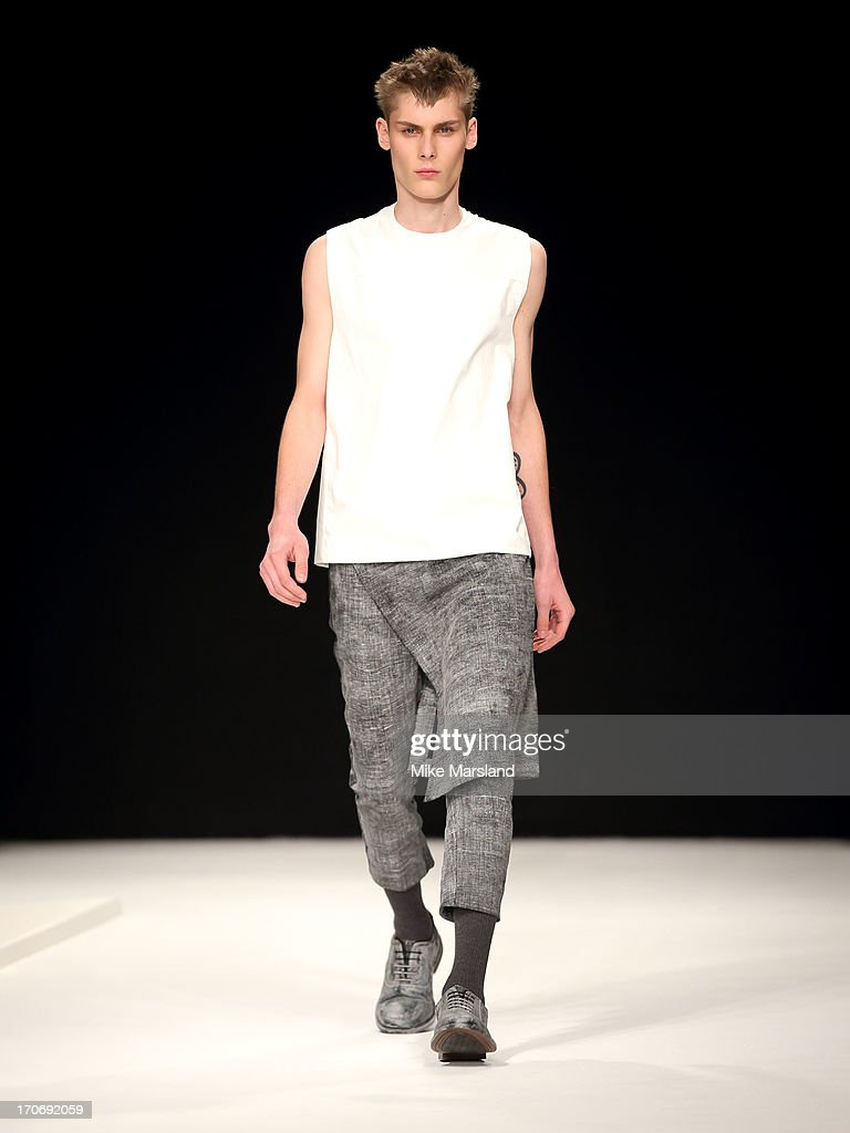 A model walks the runway at the MAN show during the London Collections: MEN SS14 at The Old Sorting Office on June 16, 2013 in London, England.