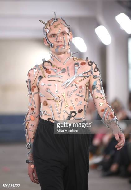 A model walks the runway at the MAN show during the London Fashion Week Men's June 2017 collections on June 10 2017 in London England