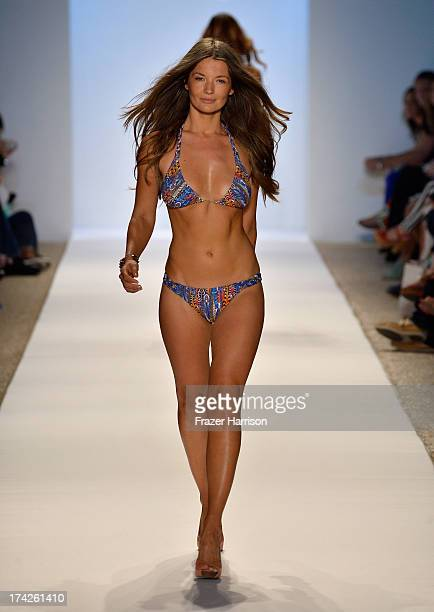 A model walks the runway at the Manglar show during MercedesBenz Fashion Week Swim 2014 at the Raleigh on July 22 2013 in Miami Beach Florida