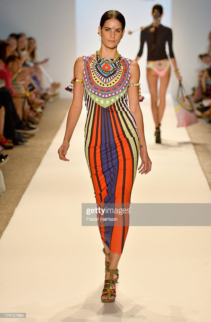 A model walks the runway at the Mara Hoffman Swim show during Mercedes-Benz Fashion Week Swim 2014 at Cabana Grande at the Raleigh on July 20, 2013 in Miami, Florida.