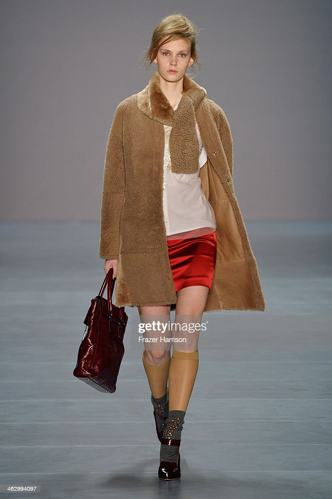A model walks the runway at the Marc Cain show during Mercedes-Benz Fashion Week Autumn/Winter 2014/15 at Brandenburg Gate on January 16, 2014 in Berlin, Germany.