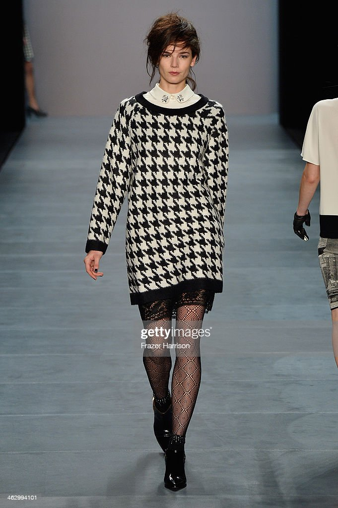 A model walks the runway at the Marc Cain show during MercedesBenz Fashion Week Autumn/Winter 2014/15 at Brandenburg Gate on January 16 2014 in...