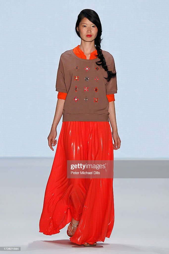 A model walks the runway at the Marc Cain Show during the Mercedes-Benz Fashion Week Spring/Summer 2014 at Brandenburg Gate on July 4, 2013 in Berlin, Germany.