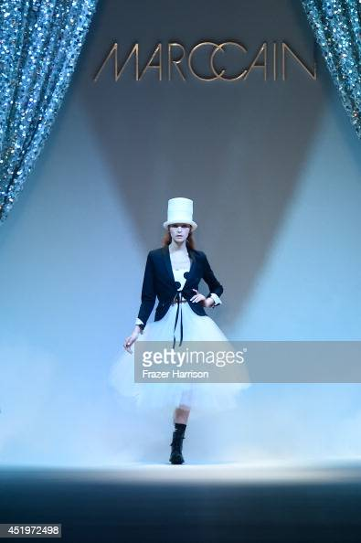 A model walks the runway at the Marc Cain show during the MercedesBenz Fashion Week Spring/Summer 2015 at Erika Hess Eisstadion on July 10 2014 in...