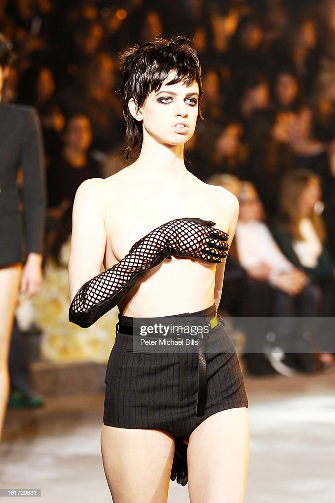 A model walks the runway at the Marc Jacobs Fall 2013 fashion show during Mercedes-Benz Fashion Week at Lexington Avenue Armory on February 11, 2013 in New York City.