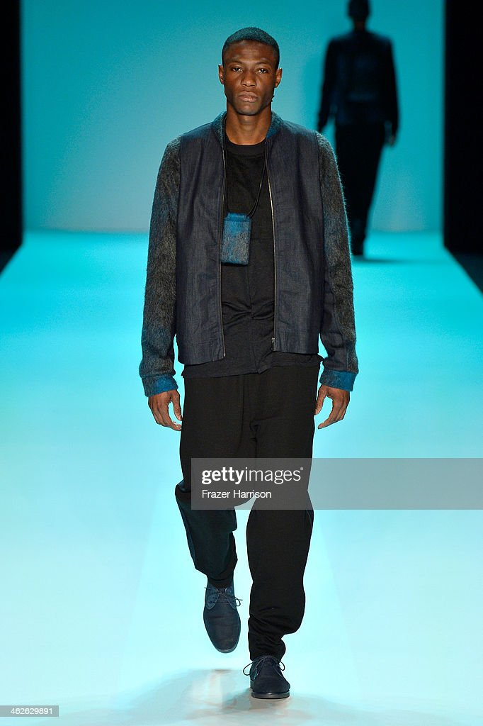A model walks the runway at the Marc Stone show during MercedesBenz Fashion Week Autumn/Winter 2014/15 at Brandenburg Gate on January 14 2014 in...