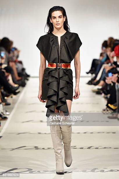 A model walks the runway at the Marcel Ostertag show during the MercedesBenz Fashion Week Berlin A/W 2017 at on January 18 2017 in Berlin Germany