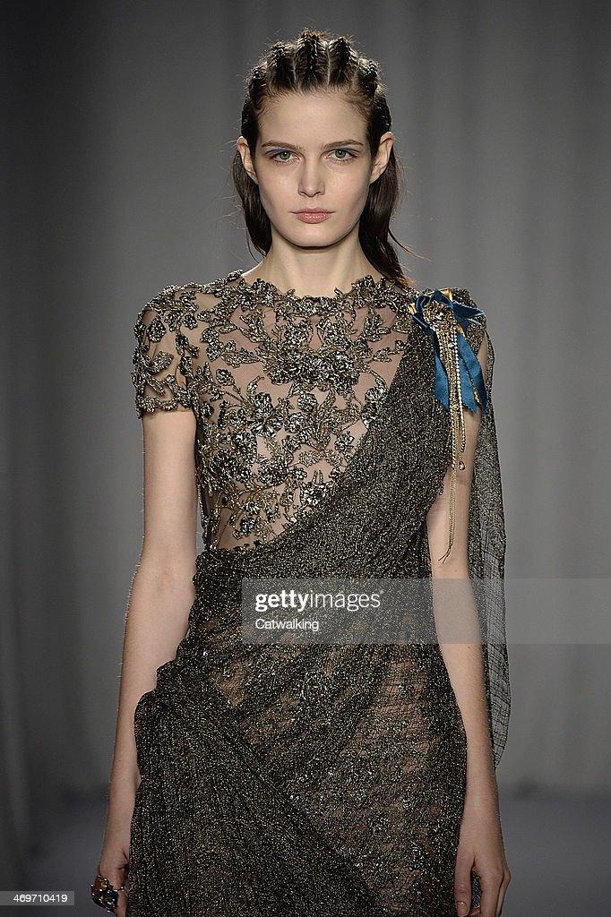 A model walks the runway at the Marchesa Autumn Winter 2014 fashion show during New York Fashion Week on February 12, 2014 in New York, United States.