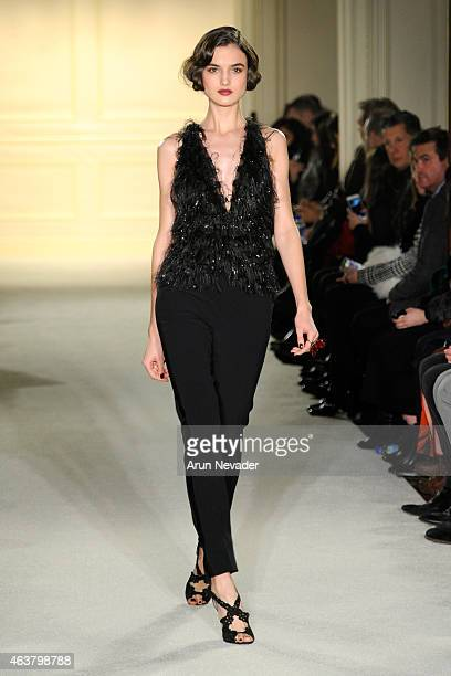 A model walks the runway at the Marchesa fashion show during MercedesBenz Fashion Week Fall at St Regis Hotel on February 18 2015 in New York City