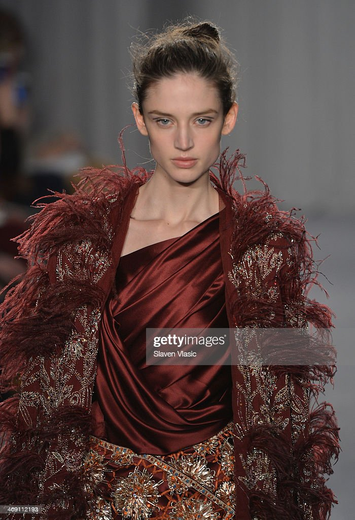 A model walks the runway at the Marchesa fashion show during Mercedes-Benz Fashion Week Fall 2014 at New York Public Library on February 12, 2014 in New York City.