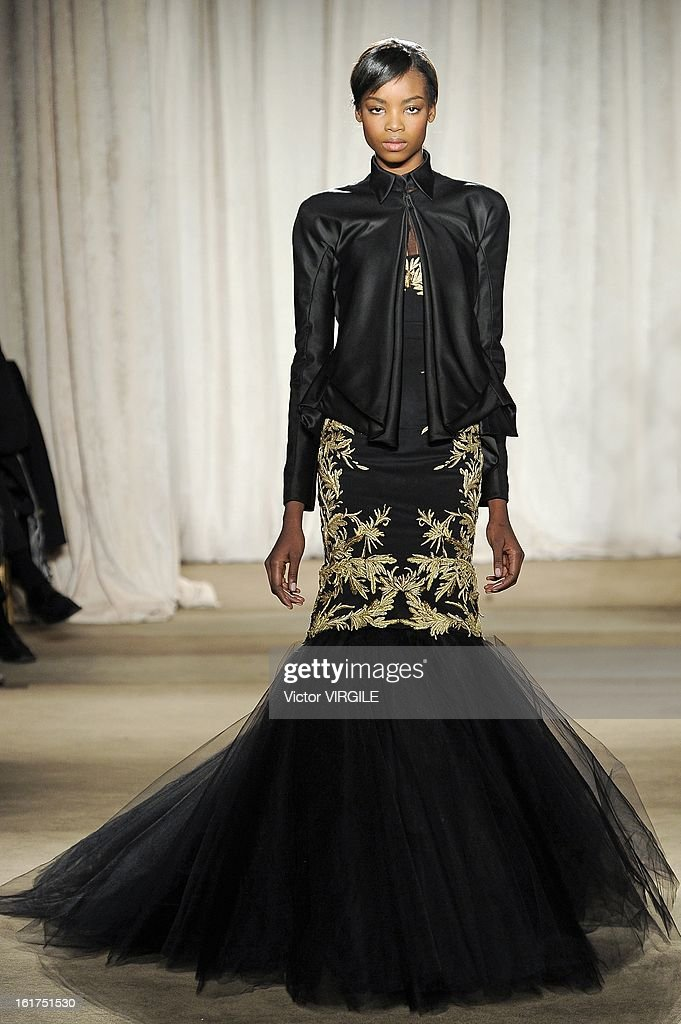 A model walks the runway at the Marchesa Ready to Wear Fall/Winter 2013-2014 fashion show during Mercedes-Benz Fashion Week at The New York Public Library on February 13, 2013 in New York City.