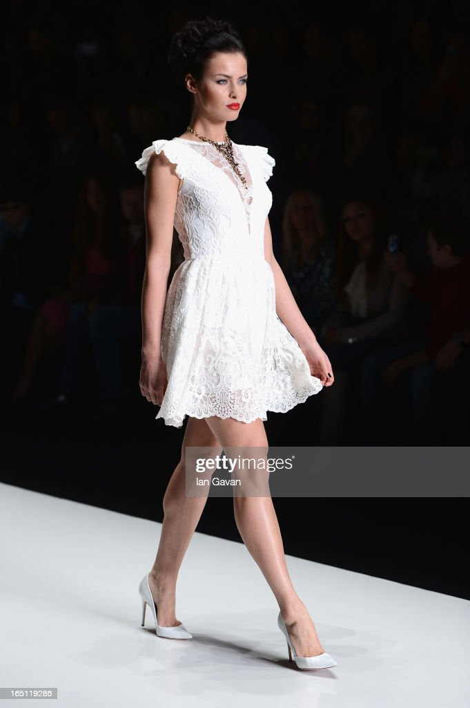 A model walks the runway at the Mari Axel show during Mercedes-Benz Fashion Week Russia Fall/Winter 2013/2014 at Manege on March 31, 2013 in Moscow, Russia.