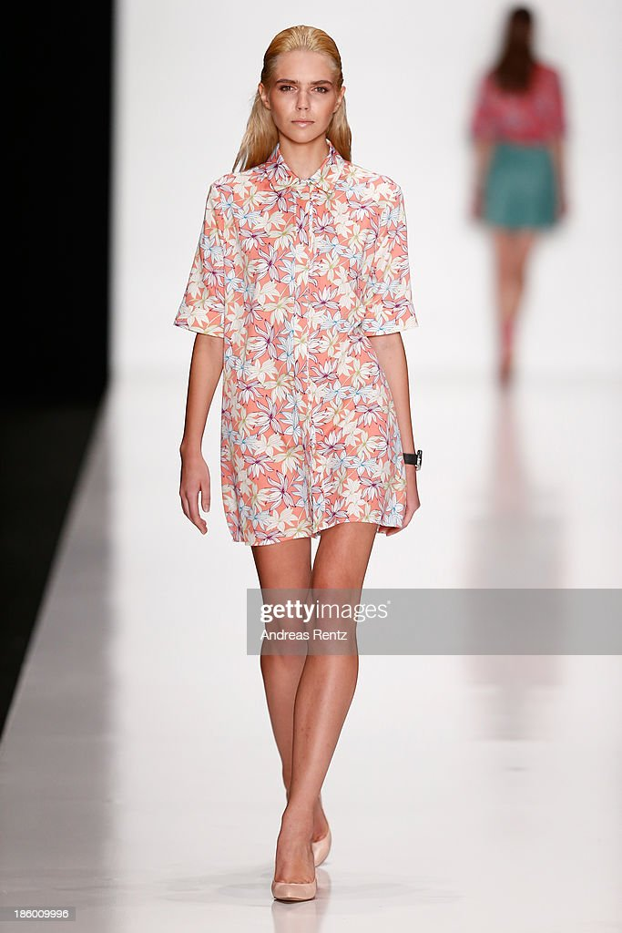 A model walks the runway at the MARI AXEL show during Mercedes-Benz Fashion Week Russia S/S 2014 on October 27, 2013 in Moscow, Russia.