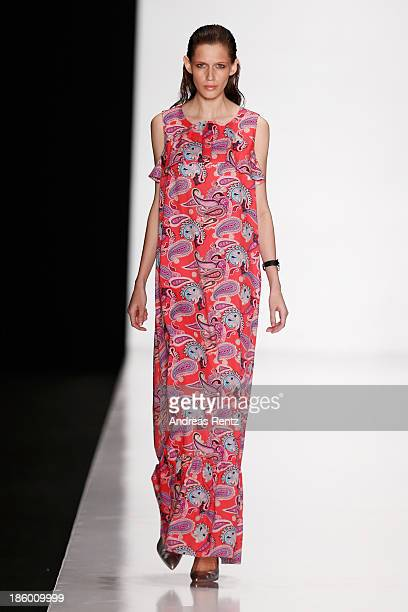 A model walks the runway at the MARI AXEL show during MercedesBenz Fashion Week Russia S/S 2014 on October 27 2013 in Moscow Russia