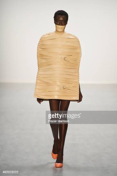 A model walks the runway at the Marina Hoermanseder show during the MercedesBenz Fashion Week Spring/Summer 2015 at Erika Hess Eisstadion on July 11...