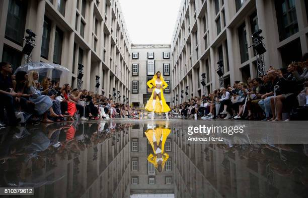 A model walks the runway at the Marina Hoermanseder show during the Berliner Mode Salon Spring/Summer 2018 at Kronprinzenpalais on July 7 2017 in...