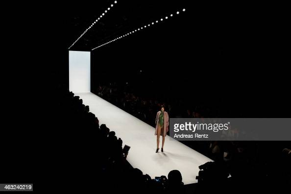 A model walks the runway at the Marina Hoermanseder show during MercedesBenz Fashion Week Autumn/Winter 2014/15 at Brandenburg Gate on January 17...