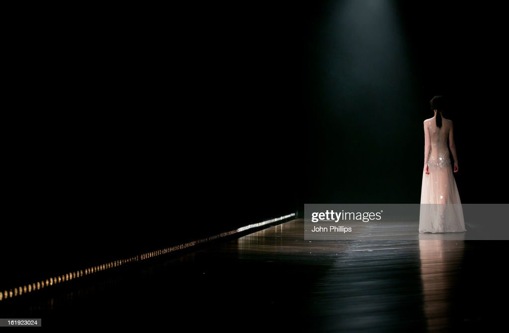 A model walks the runway at the Marios Schwab show during London Fashion Week Fall/Winter 2013/14 at Somerset House on February 17, 2013 in London, England.