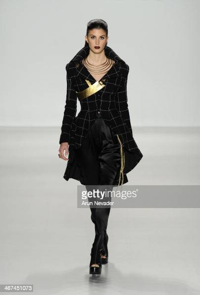 A model walks the runway at the Mark And Estel fashion show during MercedesBenz Fashion Week Fall 2014 at The Salon at Lincoln Center on February 6...