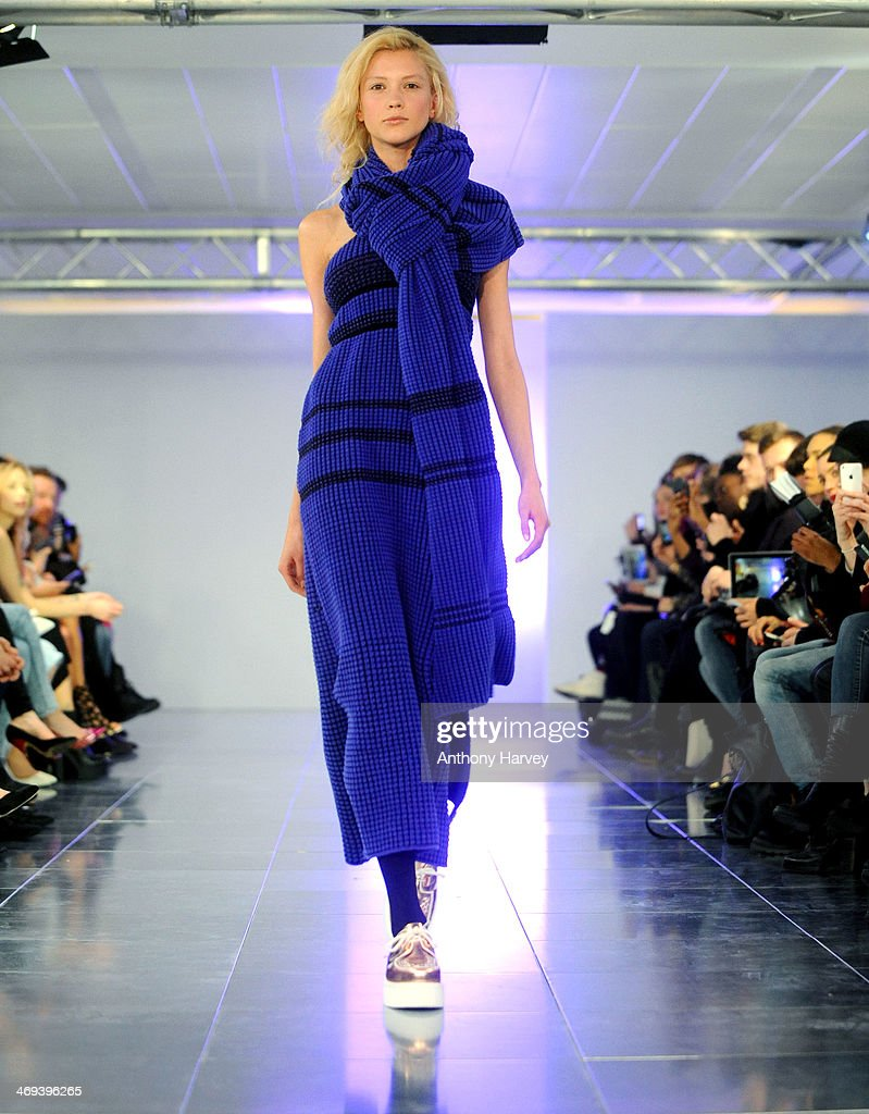 A model walks the runway at the Mark Fast show at London Fashion Week AW14 at Aldwych House on February 14 2014 in London England