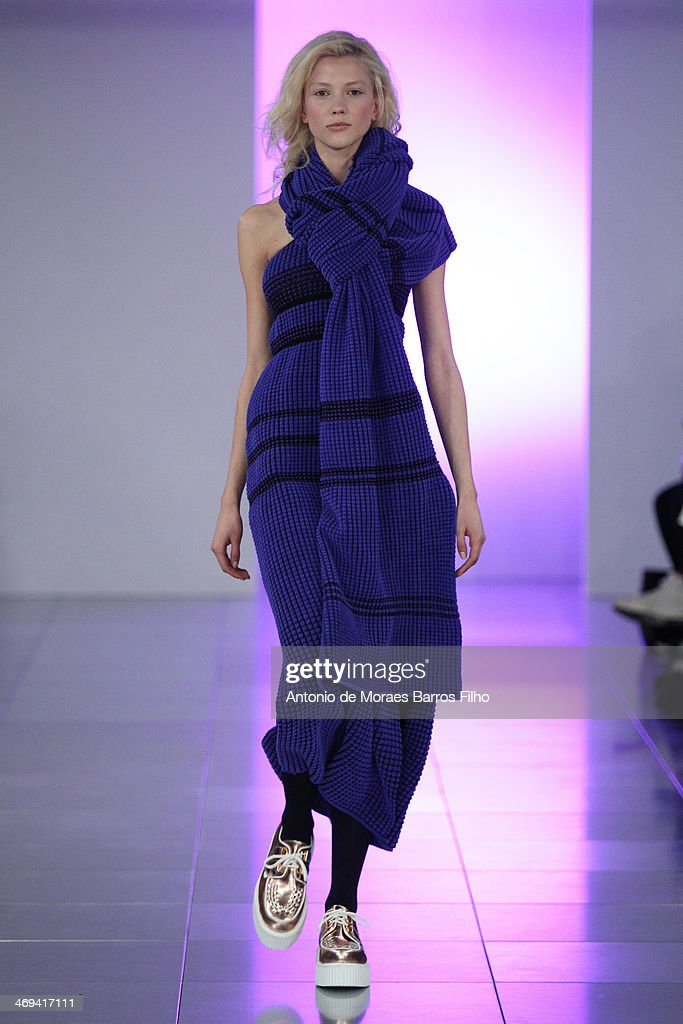 A model walks the runway at the Mark Fast show at London Fashion Week AW14 at Aldwych House on February 14, 2014 in London, England.