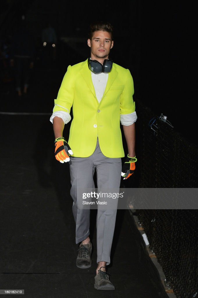 A model walks the runway at the Marlon Gobel fashion show during MercedesBenz Fashion Week Spring 2014 at Park Avenue Armory on September 9 2013 in...