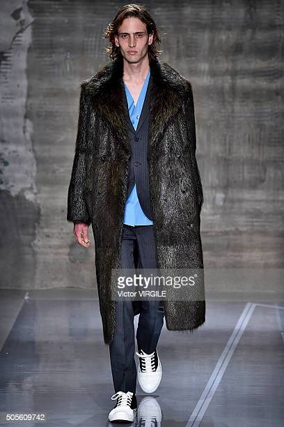 A model walks the runway at the Marni show during Milan Men's Fashion Week Fall/Winter 2016/17 on January 16 2016 in Milan Italy