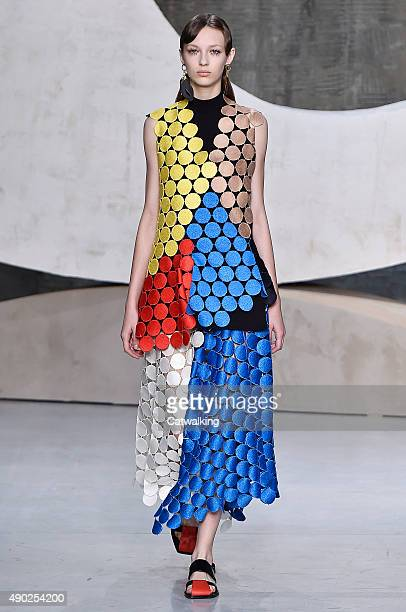 A model walks the runway at the Marni Spring Summer 2016 fashion show during Milan Fashion Week on September 27 2015 in Milan Italy