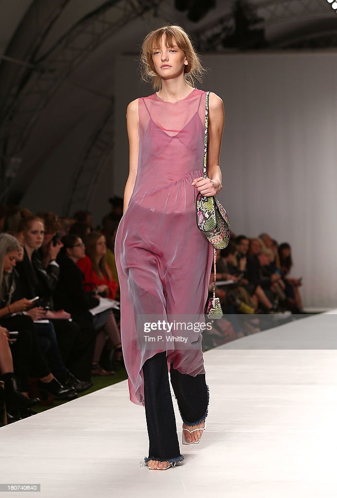 A model walks the runway at the Marques'Almeida show during London Fashion Week SS14 at TopShop Show Space on September 16, 2013 in London, England.