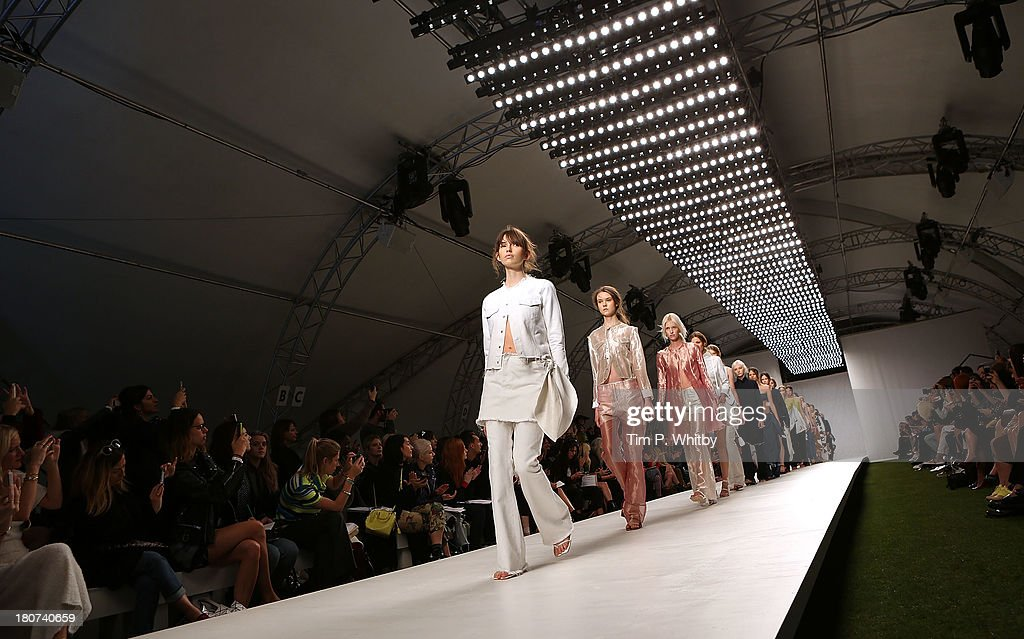 Model walks the runway at the Marques'Almeida show during London Fashion Week SS14 at TopShop Show Space on September 16, 2013 in London, England.