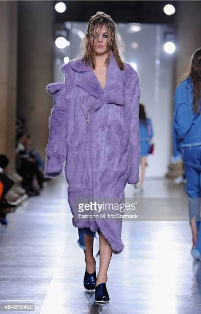 A model walks the runway at the Marques'Almeida show during London Fashion Week Fall/Winter 2015/16 at TopShop Show Space on February 24 2015 in...