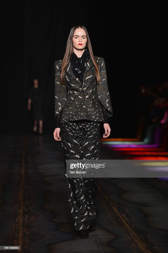 A model walks the runway at the Masha Kravtsova show during Mercedes-Benz Fashion Week Russia Fall/Winter 2013/2014 at Manege on April 1, 2013 in Moscow, Russia.