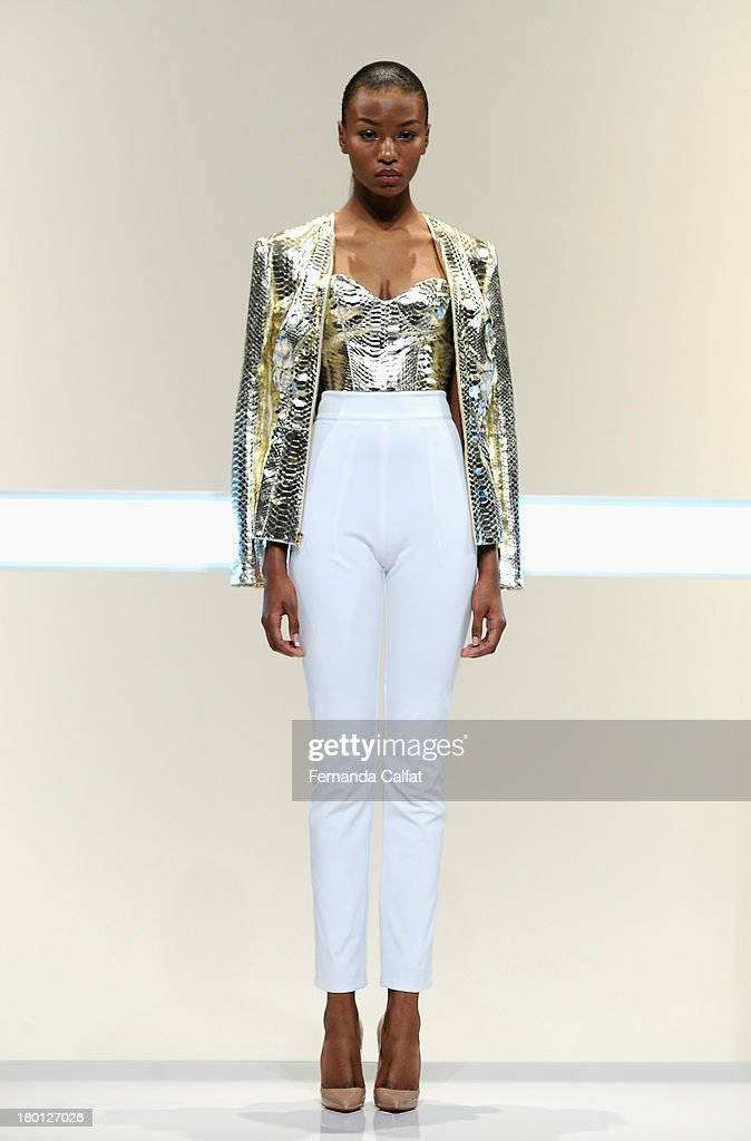 A model walks the runway at the Mathieu Mirano fashion show during Mercedes-Benz Fashion Week Spring 2014 at The Studio at Lincoln Center on September 9, 2013 in New York City.