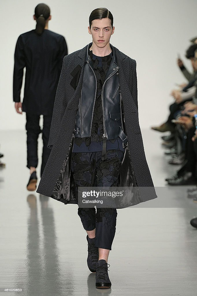 A model walks the runway at the Matthew Miller Autumn Winter 2014 fashion show during London Menswear Fashion Week on January 6, 2014 in London, United Kingdom.