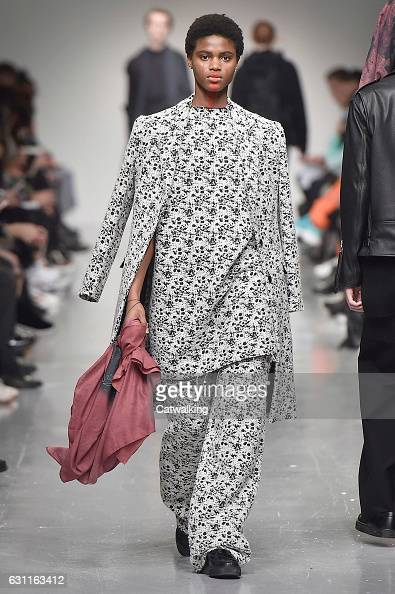 A model walks the runway at the Matthew Miller Autumn Winter 2017 fashion show during London Menswear Fashion Week on January 7 2017 in London United...