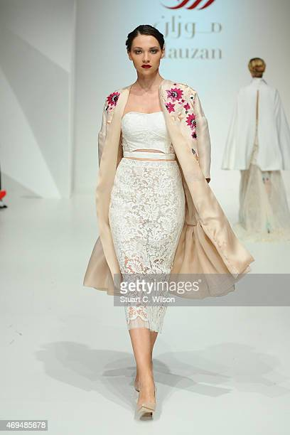 A model walks the runway at the Mauzan show during Dubai Fashion Forward April 2015 at Madinat Jumeirah on April 12 2015 in Dubai United Arab Emirates