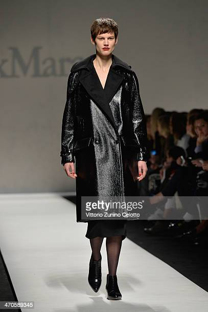 A model walks the runway at the Max Mara Show during Milan Fashion Week Womenswear Autumn/Winter 2014 on February 20 2014 in Milan Italy