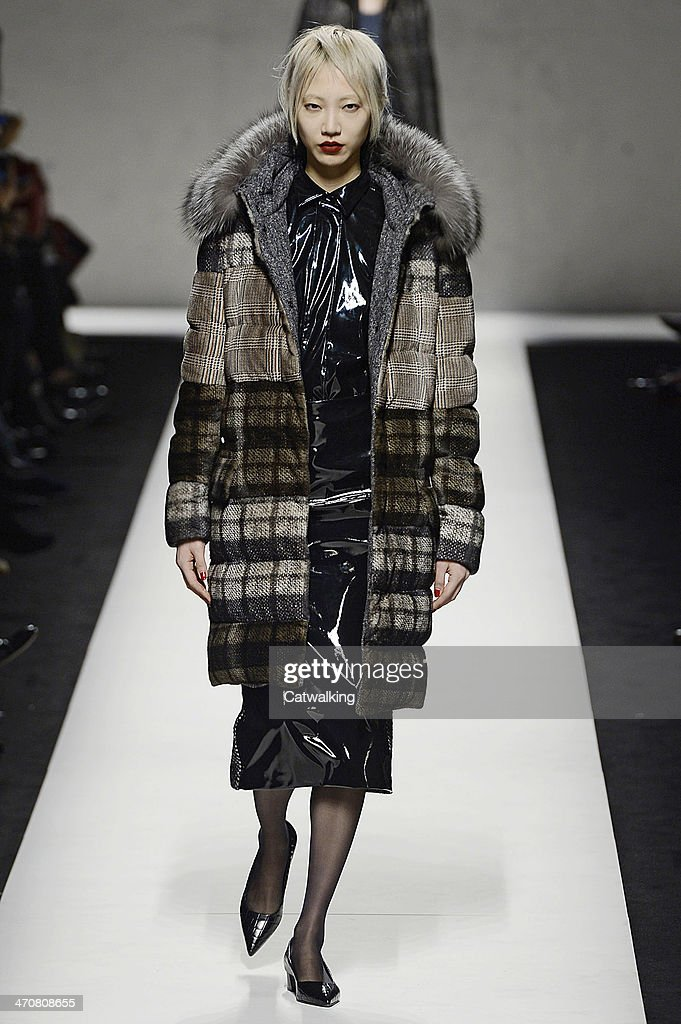 A model walks the runway at the MaxMara Autumn Winter 2014 fashion show during Milan Fashion Week on February 20, 2014 in Milan, Italy.