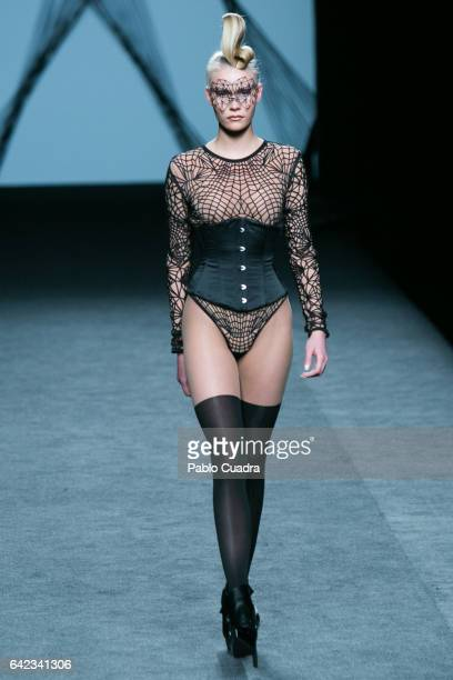 A model walks the runway at the Maya Hansen show during the MercedesBenz Madrid Fashion Week Autumn/Winter 2017 at Ifema on February 17 2017 in...