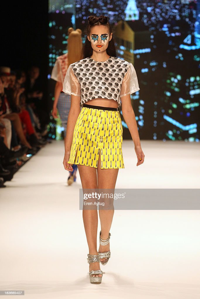A model walks the runway at the Maybelline New York By DB Berdan show during Mercedes-Benz Fashion Week Istanbul s/s 2014 presented by American Express on October 8, 2013 in Istanbul, Turkey.