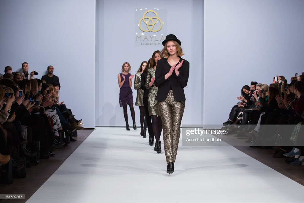 A model walks the runway at the Mayla show during Mercedes-Benz Stockholm Fashion Week AW14 on January 28, 2014 in Stockholm, Sweden.